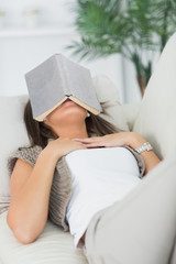 Brunette sleeping with her book on the head