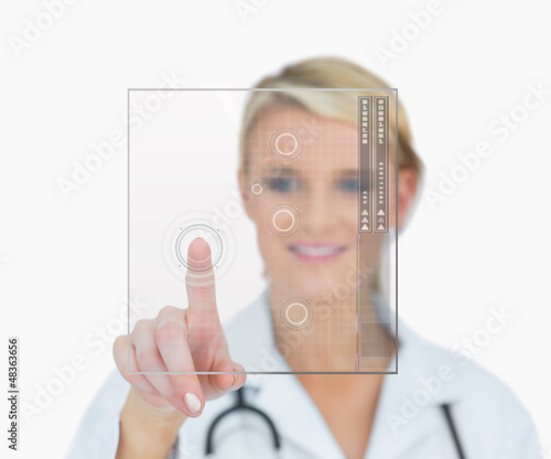 Doctor touching holographic interface