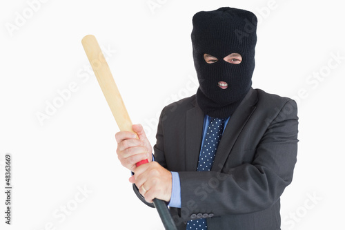 Smiling businessman dressing like a burglar