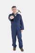 Male technician holding hammer