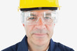 Mechanic wearing hardhat and protective glasses