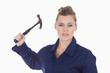 Female technician holding claw hammer