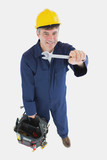 Mature mechanic with spanner carrying tool bag