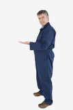 Mature technician gesturing