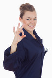 Happy female technician showing ok sign