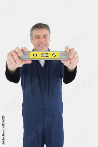 Technician with spirit level