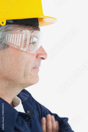 Mature mechanic looking away