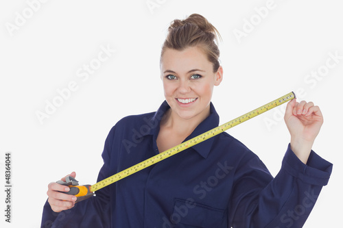 Female technician holding measuring tape