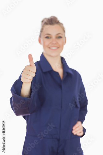Female mechanic showing thumbs up sign