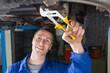 Man repairing car with pliers