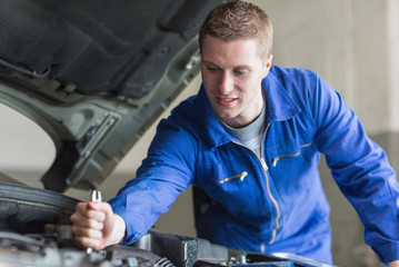Mechanic working on automobile engine