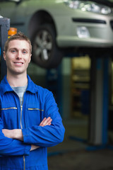 Smart car mechanic smiling