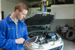 Auto mechanic working on tablet pc