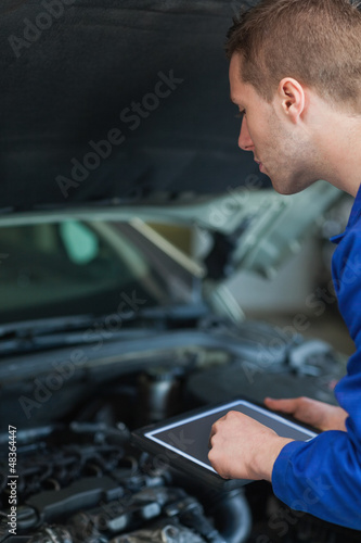 Mechanic using digital tablet