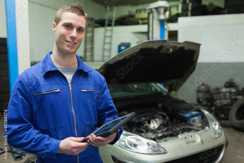 Auto mechanic holding tablet computer