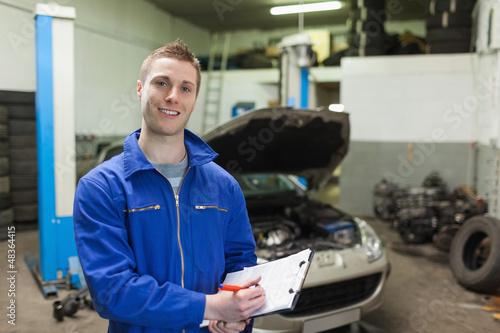 Mechanic writing on clipboard