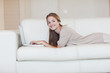Portrait of woman using laptop on sofa