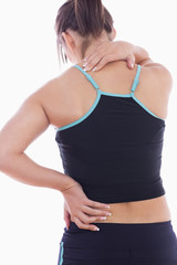 Rear view of sporty young woman massaging neck