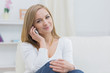 Portrait of casual woman using mobile phone at home