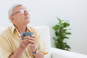 Elderly cheerful man looking away