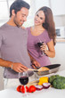 Lovers preparing food and drinking