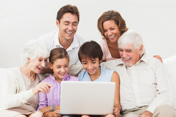 Extended family looking at laptop