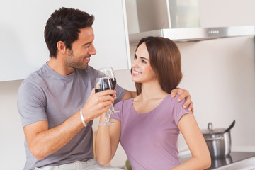 Lovers toasting with a glass of wine