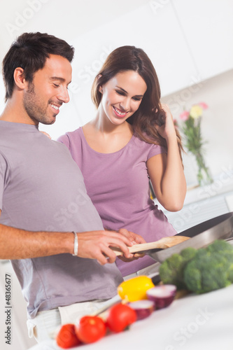 Happy couple making dinner