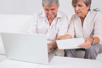 Old couple not understanding the accounts and using laptop