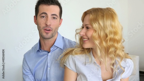 Young couple talking to camera