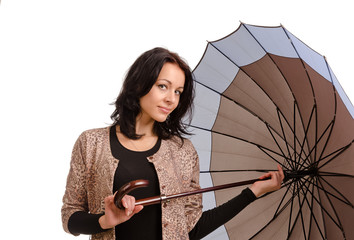 Beautiful brunette woman holding an umbrella