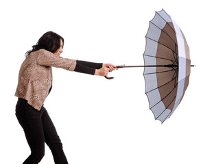 Woman battling with her umbrella in wind