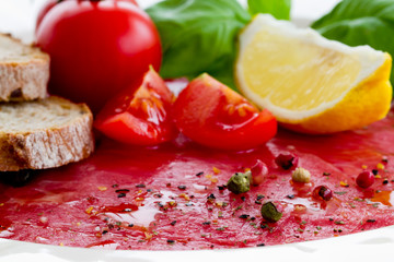 Carpaccio with basil and tomatoes