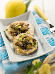 grilled swordfish with mushrooms and lemon peel, selective focus