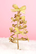 Wire Christmas tree on pink background