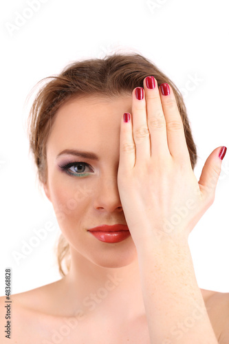 beautiful young woman covers her face