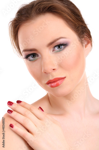 Beautiful young woman with bright make-up isolated on white
