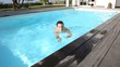 Man swimming in private swimming-pool