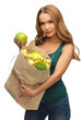 woman with shopping bag full of fruits