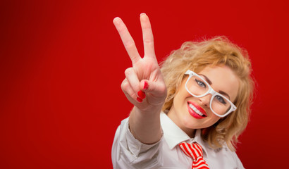 Smile young woman showing with fingers peace