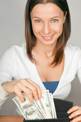young woman with cash