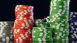 Casino chips stacks on black background.