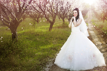 Beautiful bride in blossom garden
