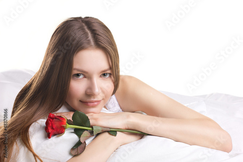 young woman with rose  in a beg