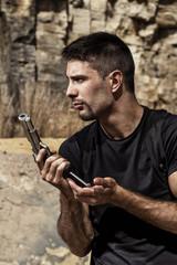 menacing man reloading a handgun