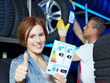 Happy female customer shows thumb up for EU tire labeling