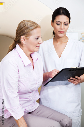 Female Technician With Patient