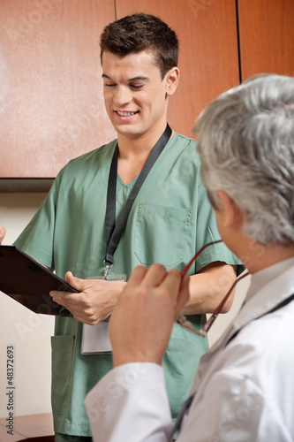 Male Technician Holding Clipboard