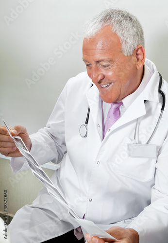 Radiologist Reviewing Ultrasound Print