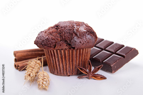 chocolate muffin and ingredient on white